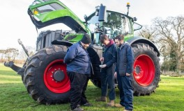Agricultural Engineering students working with a tractor